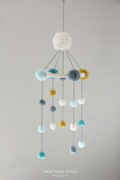 Your place to buy and sell all things handmade - Your place to buy and sell all things handmade Baby Pom Mobile in Aquas and Light Mustard by SwartwoodStudio Baby Crafts, Diy And Crafts, Crafts For Kids, Arts And Crafts, Pom Pom Baby, Pom Poms, Pom Pom Crafts, Diy Décoration, Fun Diy