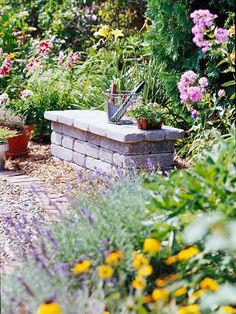 garden bench - This could be done with concrete block on bottom & slab of wood or nice blocks on top