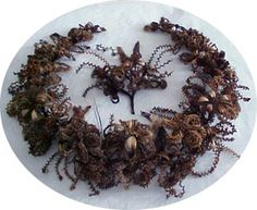 Victorian Mourning Hair Art Wreath. Made from deceased loved one's hair. Each color represents a different loved one.