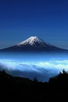 Mount Fuji, Japan I have a thing for Mt Fuji. I thought this photo with the white snow and the dark base might work some how.