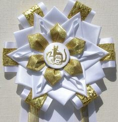 View our collection of ribbons and rosettes available in accents including floral, patterned, glittery golds, silvers and more. Ribbon Rosettes, Ribbons, Centaur, Garter, Homecoming, Photo Galleries, Keto, Floral, Ideas