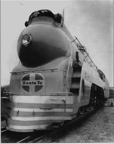 In January, 1938, Baldwin delivered a streamlined Hudson to the Santa Fe. The locomotive weighed about 8,000 pounds and cost about $15,000 more than non-streamlined Hudsons in the same order. Although the Santa Fe planned to use the locomotive with its passenger trains, it made no attempt to replicate the Warbonnet color scheme, instead painting the locomotive light blue.
