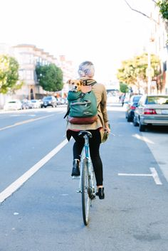 22 Chic Bikers Zipping In S.F. #refinery29  http://www.refinery29.com/biker-style#slide31  Valencia Street: Nicole Browner, freelance production coordinator and multimedia director at The Bay Bridged, is dog going, going, gone!