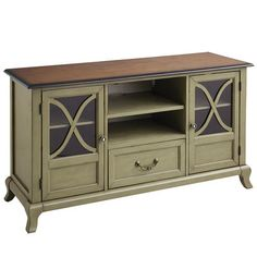 Outer beauty: Antiqued brass hardware, European style in a soft sage tone and a slim profile. Inner beauty: One felt-lined drawer with dovetail construction, two glass cabinet doors, three adjustable shelves and a cord management cutout for added practicality. If it were any more beautiful, it would be in a pageant.