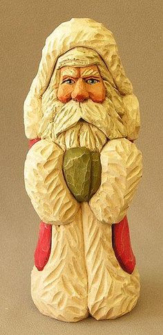 Santa woodcarving with red coat trimmed in white by Russell From ScottCarvings.com