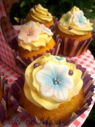 Yellow buttercream cupcakes with flowers for a wedding