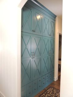 Blue Mudroom lockers with drawers below. Built by SeansWoodworking.com