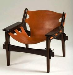 I bought a Kilin Chair by Sergio Rodrigues  yesterday.   I had no idea of its identity or origin but thought it was unusual..  I paid $20. for it.  I found out it is worth upwards of $2500.    The picture is similar but this has more pegs and ornamentation. Mine is from the 50's to early 60's.