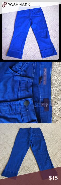 "EUC NYDJ Dayla Wide Cuff Capri Excellent, gently used NYDJ Dayla wide cuff capri jeans. Size 8, lightweight denim with ""Lift and Tuck Technology"". Worn and washed once. Great summer denim! Pet free, smoke free home. NYDJ Jeans Ankle & Cropped"