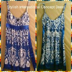 Beautiful International Concepts Summer Dress Beautiful International Concepts summer stylish dress size 3 juniors - women, has a floral print with blue, white and silver, midi, small strap, also has a silk tie banded waist and bottom, with a silk ribbon tie back for waste. This beautiful stylus dress would make a great dress for summer you can dress it up or dress it down. New with tag International Concepts Dresses Midi