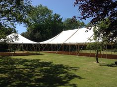 We know the summer has arrived when we start to put our lovely canvas pole tents up again. This one is brand new this season and comes with walls and windows but can be used as shown without either if the weather and occasion permits. When Us, Tents, Golf Courses, Sidewalk, Environment, Walls, Weather, Windows, Seasons