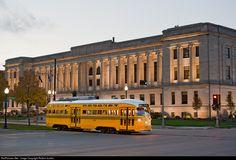 "Kenosha Transit PCC 4616 ""Cincinnati Street Railways"" car pass the 1925 Neoclassical Kenosha County Court House on Government Square."