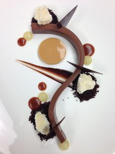 Pliable 70% ganache, chocolate crumble, caramel sauce, yuzu gel, caramel cream, chocolate sauce, chocolate plaques, calamansi sorbet