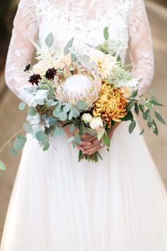 Adding a statement succulent to your bridal bouquet really makes your whole look POP! | Rancho Santa Fe Real Wedding: Devon & John | Exquisite Weddings