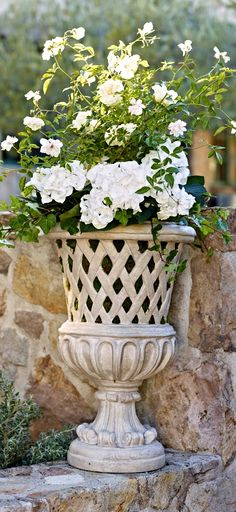 An impressive accent for your home's grand entrance or outdoor patio, our stately Pela Planters provide a striking vessel for lush topiaries or vibrant floral arrangements.