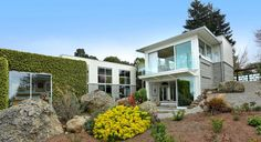 """The latest offering from Bebe McRae of the Grubb Co. rests in the northern hills of Berkeley and hosts dramatic architecture with unparalleled versatility.  """"The seller has viewed this compound as a true sanctuary from a demanding life and busy schedule,"""" McRae said of 12 Ajax Place and 90 Hill Road, two homes set near the storied Tilden Park.  The older of the two listings (90 Hill Road) is a revitalized two-level midcentury with a wraparound deck overlooking San Francisco ..."""