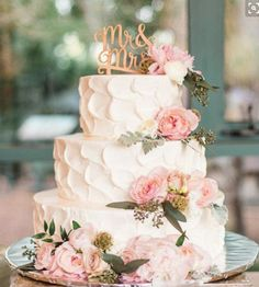 Could we fit some loose extra flowers into the budget to add to our cake (maybe not this much, but a slightly more modest amount!)