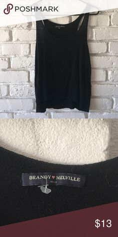 Super soft black tank top Super cute black tank top made of super soft and comfy Brandy Melville material.  Super cute and hardly worn so it's in amazing condition Brandy Melville Tops Tank Tops
