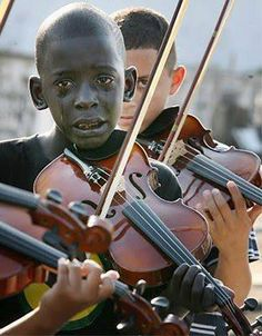 Diego of the Violin. He was playing the violin on his violin's teacher funeral. After 6 moths he dead of cancer :((( --- RJ, Brazil