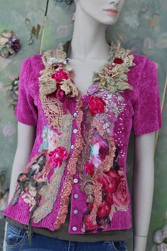 Whimsy soft cardi (chenille knit) in pink magenta shade.. reworked and adorned with tattered/sculpted old laces and torn gauze, printed silks, /appliques and vintage trims, accentuated with pale pink seed beadsand rose wine pearls, velvet blooms, baroque cameo image. Fastens with small