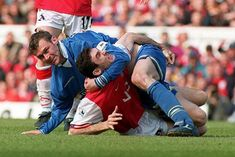 Martin Keown and Duncan Ferguson have a friendly hug.
