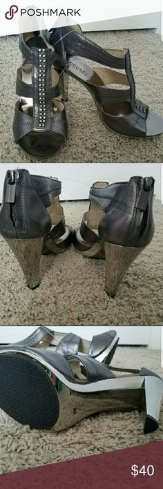 Brand new Michael Kors Heels Gorgeous grey heels with rhinestone detail and silver heels from Michael Kors.  Perfect condition, amazing grip on the bottom too! Michael Kors Shoes