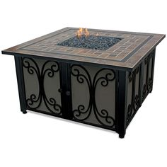 Claremont Gas Fire Bowl features a bronze fire glass and tile hearth. The sides are fabric paneled with a decorative iron filigree overlay, concealing the propane tank beneath.