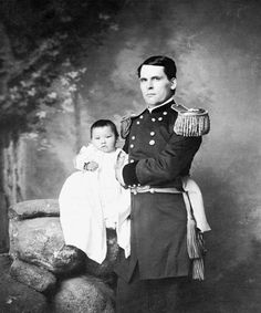 This baby girl, Zintkala Nuni (Little Lost Bird), was found on the battlefield after the massacre of Wounded Knee; she is being held by General L. W. Colby of the Nebraska State Troops, 1890.