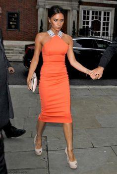 Victoria Beckham in orange cocktail dress