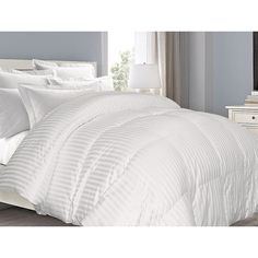 This white down comforter is the definition of comfort with its 350 cotton-thread-count and 100 percent cotton fill. The striped damask weave design of this comforter has a subtle elegance that is per