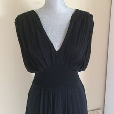 Banana Republic Black Dress. Very good condition. Not fated. Shell: 50% silk, 44% rayon. Lining: 100% polyester. Lining under all dress. Stretchable. Very comfortable dress. Decorative Stretchable Belt around the waist. Banana Republic Dresses Midi
