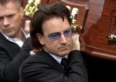 24/8/2001 -  Bono bears the coffin of his father, Bob Hewson, supported by Larry Mullen following the funeral service. Picture: Matt Kavanagh/The Irish Times