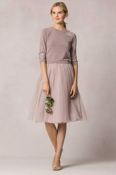 Love the sweater and tulle skirt combo.
