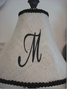 Burlap covered lamp shade. stenciled initial and trim. easy and pretty!