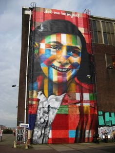 Artist: Eduardo Kobra Location: NSDM Warf Amsterdam, Netherlands Style: Kaledoscopic 240 square meters, more than 500 spraycans, 40 liters of glossy paint Depicting: Anne Frank Lloyd Hotel Amsterdam, Victoria Hotel Amsterdam, Visit Amsterdam, Amsterdam City, Amsterdam Netherlands, Amsterdam Red Light District, Glossy Paint, Anne Frank, Outdoor Art