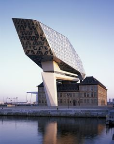 World Architecture Community News - Zaha Hadid Architects crowns Belgium's historic Antwerp Port Building with a floating glazed tower Zaha Hadid Architecture, Architecture Antique, Futuristic Architecture, Beautiful Architecture, Contemporary Architecture, Art And Architecture, Unique Buildings, Interesting Buildings, Amazing Buildings