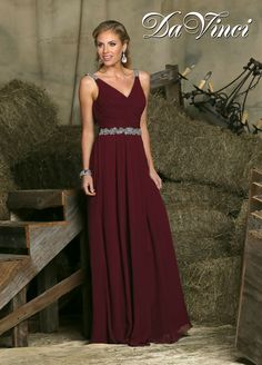 Find effortless class with flair in DaVinci Bridesmaid Style 60225. One of our few Grecian bridesmaids dresses designs, this gown has a pleated bodice with a faux-wrap, V neck and a long, gathered chiffon skirt. Pretty beaded accents at the natural waist & shoulder add shine and make this one of our most stunning bridesmaid dresses this season. Like many of our Fall 2015 bridesmaids dresses, pictures don't do it justice. See it in person in bordeaux (shown) or one of our other 50+ chic…