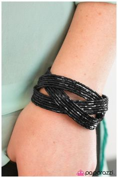 Shooting Stars - Black $5.00  Layers of black seed beads are braided together to create a breathtaking cuff design that shimmers brilliantly along the wrist.  Sold as one individual bracelet.