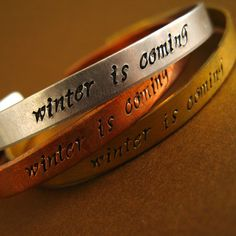 """Hand stamped Game of Thrones #Bracelet - """"Winter is Coming"""" (House Stark) by SpiffingJewelry on Etsy. The lettering really pops after being oxidized! #gameofthrones"""