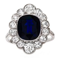 Regal Edwardian Era Engagement Ring with Deep Blue Sapphire Center   From a unique collection of vintage engagement rings at https://www.1stdibs.com/jewelry/rings/engagement-rings/
