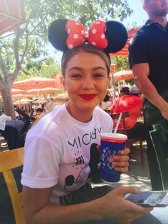 "Gigi Hadid and boyfriend Joe Jonas (aka G.I. Joe) spend the day at Disneyland with friends. The model tweeted a group photo from inside the theme park, followed by this snap of her wearing  Minnie Mouse's classic bow-adorned ears, with the caption, ""Disneyland doesn't make me happy I swear.""   - HarpersBAZAAR.com"