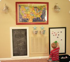play wall: framed map (makes it dry erase), frame with blackboard paint (can make any color) dry erase board and hanging buckets with chalk and markers.