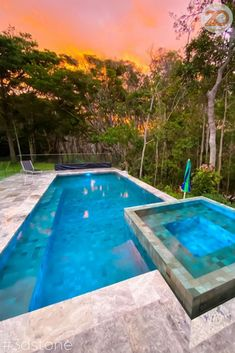 """Fiery sky's + Sukabumi pool delights! What a stunning view. Fully tiled pool and spa and travertine coping surrounds for top-notch luxury and holiday vibes at home. We echo what @suncatcherpools says """"We love when our clients share their pool pics with us! Especially in times like these, it keeps us moving forward and continue to create amazing pools for you!"""" #sukabumi #travertine #pooltile #poolcoping #naturalstone #3dstone"""