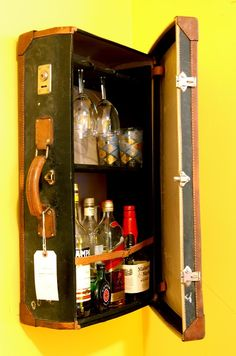 A n z u: Repurposed suitcases drink cabinet or medicine cabinet made from vintage suitcases.
