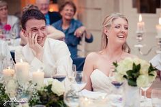 A bride and groom laugh during the best man speech at their classic new england wedding outside of Boston, Massachusetts Gina Brocker Photography