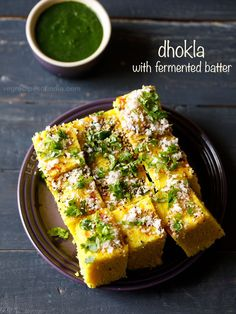 dhokla recipe with step by step pics. dhokla is a very popular snack from the gujarati cuisine. this dhokla recipe is fermented and made with chana dal and rice batter. they taste too good and make for a delicious snack. Healthy Recipes, Gourmet Recipes, Vegetarian Recipes, Snack Recipes, Cooking Recipes, Healthy Snacks, Snacks Ideas, Free Recipes, Dessert Recipes