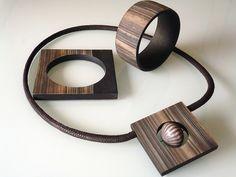 "by Angela Garrod aka Claynine, Cuffs and Pendant "" Norwegian Wood "" on her Flickr site."
