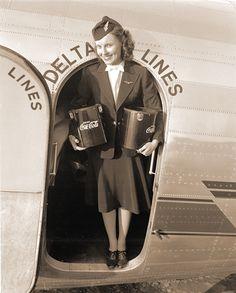 Delta Airlines Flight Attendant, then called Stewardess, carrying Coca-Cola buckets. Delta Flight Attendant Uniform, Flight Attendant Life, Airline Travel, Airline Flights, Air Travel, Victor Hugo, Airline Uniforms, Vintage Travel Posters, Vintage Airline