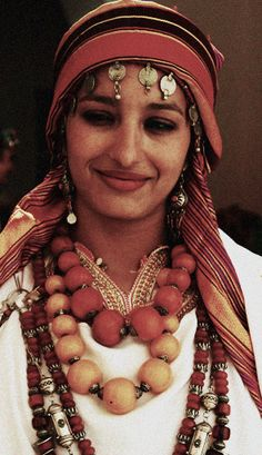 A young Berber woman wearing traditional jewellery and costume.  Marrakech, Morocco.