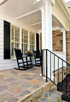 Porch tile, like color pallet variety + stone fascia and steps.